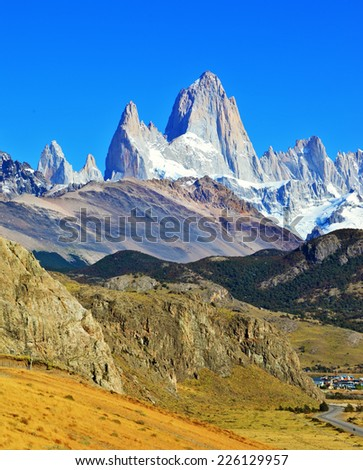 Famous rock Fitz Roy peaks in the Andes. Magnificent panorama of snow-capped mountains in Patagonia - stock photo
