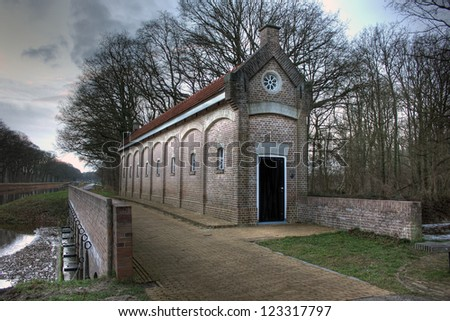 Famous Schuivenhuisje (Dinkelhouse) at Canal Almelo - Nodhorn, The Netherlands - stock photo
