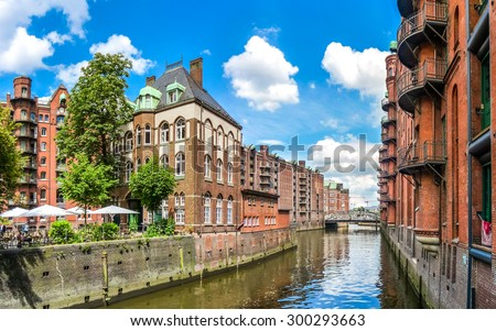 Famous Speicherstadt warehouse district with blue sky and clouds in Hamburg, Germany - stock photo