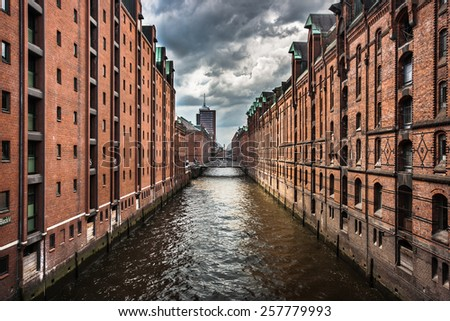 Famous Speicherstadt warehouse district with dark clouds before the storm in Hamburg, Germany - stock photo