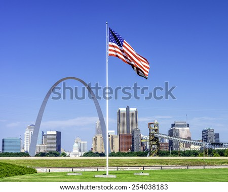 Famous St. Louis arch and American Flag - stock photo