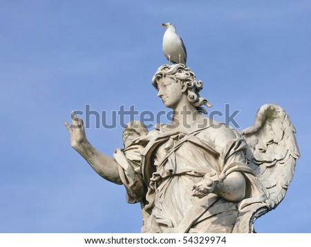 Famous statue of an angel. Michaelangelo bridge. Rome. Italy. More of this motif & more Rome in my port. - stock photo