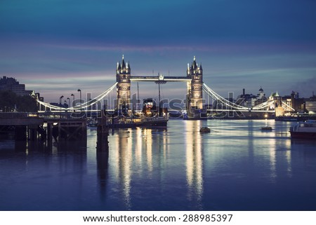 Famous Tower Bridge by night, London, England, United Kingdom, vintage filtered style  - stock photo