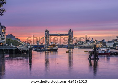 Famous Tower Bridge in front of colorful sky at morning before sunrise, London, England, United Kingdom  - stock photo