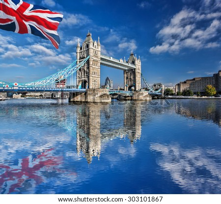 Famous Tower Bridge with flag of England in London, UK - stock photo