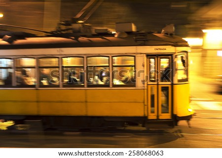Famous tram 28 at night in Lisbon, Portugal. Motion Blur - stock photo