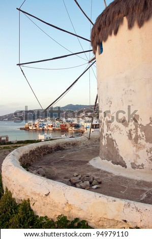 Famous windmill of Mykonos on the background of Little Venice at sunset - stock photo