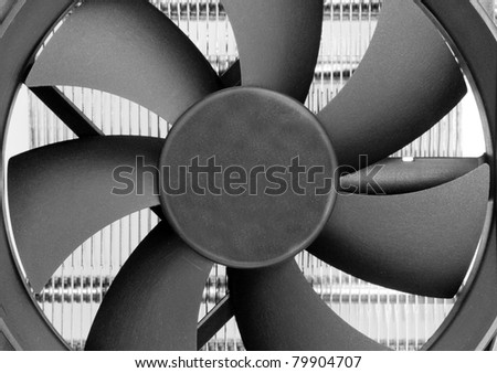 Fan blades of computer processor cooler. Close-up view - stock photo