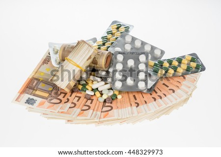 Fan from fifty euros and medical tablets. Many mass currency isolated on white background. Euro cash. Money for the purchase of medicines, drugs or narcotic. Bill and pills - stock photo