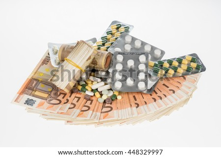 Fan from fifty euros and medical tablets. Many mass currency isolated on white background. Euro cash. Money for the purchase of medicine, drugs or narcotic. Bill and pills - stock photo