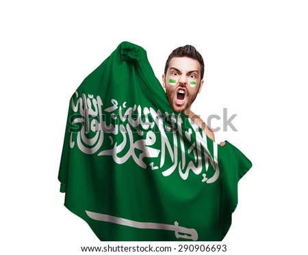 Fan holding the flag of Saudi Arabia on white background - stock photo
