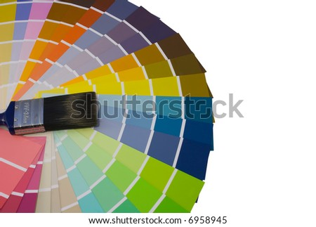 Fan of colour swatches and paint brush - stock photo