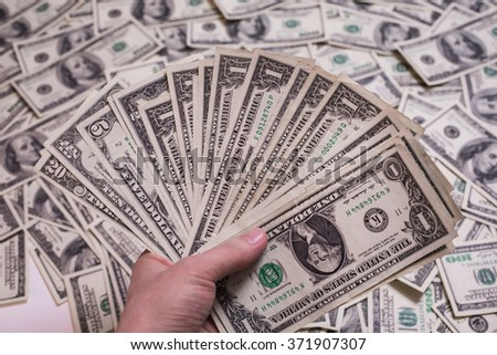 fan of money, a fan of one dollar bills, one dollar bill face, thirst for wealth, detail, renting, pocket money, money background - stock photo