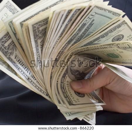 fan of money in hand - stock photo