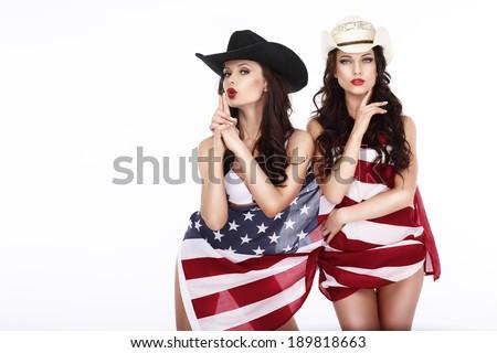 Fanciful Joyful Women Cowgirls and American Flag - stock photo