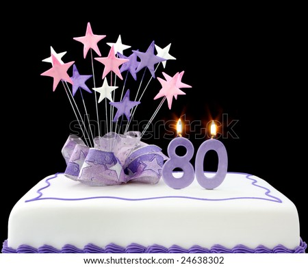 Fancy cake with number 80 candles.  Decorated with ribbons and star-shapes, in pastel tones over black background. - stock photo