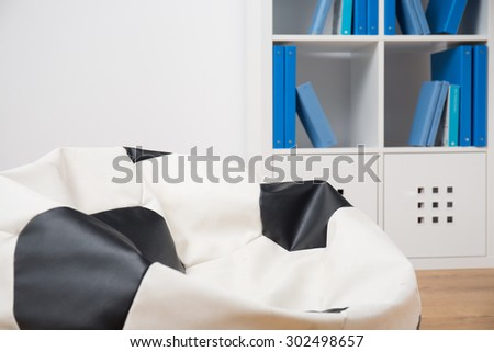 Fancy comfortable armchair bag in room for teenager - stock photo