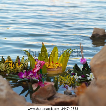 Fancy Krathong on the river after the festival. - stock photo