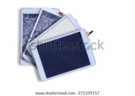 Fanned arrangement of four tablets with blank screens showing two with smashed broken glass and two with repaired screens in the corner on white with copy space - stock photo