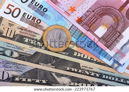 Fanned out banknotes of euros, dollars and Russian coin. Closeup. - stock photo