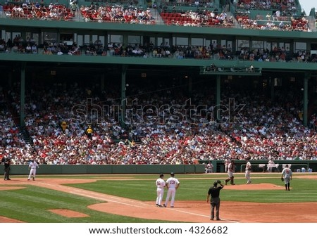fans and baseball players at fenway park - stock photo