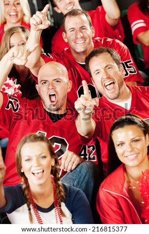 Fans: Football Fans Excitedly Cheering Directly To Camera - stock photo