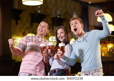 Fans of beer in a pub - stock photo