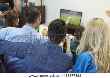 Fans of soccer watching match