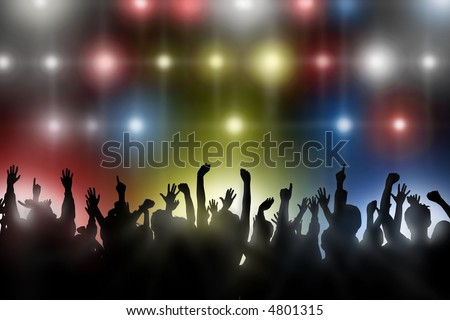 Fans raise their hands at concert - stock photo
