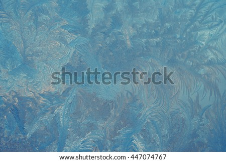 Fantastic abstract winter background (frost pattern on a window glass), retro style - stock photo