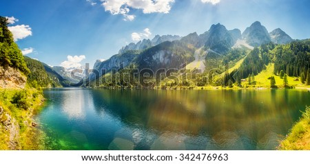 Fantastic azure alpine lake Vorderer Gosausee. Unusual and picturesque scene. Salzkammergut is a famous resort area located in the Gosau Valley in Upper Austria. Dachstein glacier. Beauty world. - stock photo