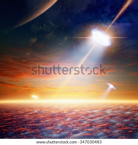 Fantastic background - alien spaceship shines spotlight, aliens invasion. Elements of this image furnished by NASA nasa.gov - stock photo