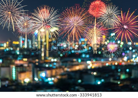 Fantastic festive new years colorful fireworks on cityscape blurred photo bokeh in celebration night - stock photo