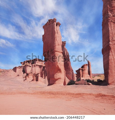 Fantastic formations in Red rock canyon. Talampaya National Park, declared UNESCO World Heritage SIte. La Rioja. Argentina.  - stock photo