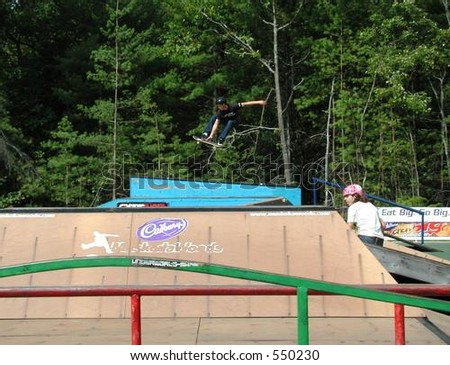 Fantastic grab off box jump at Muskoka Woods Amateur Open in Ontario - stock photo