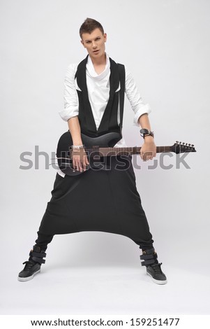 Fantastic man in studio holding a guitar  - stock photo