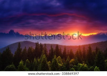 Fantastic mountain glowing by sunlight. Dark overcast sky in the morning. Dramatic and picturesque scene. Location Svaneti, Georgia, Europe. Beauty world. Creative collage. Soft filtered effect. - stock photo