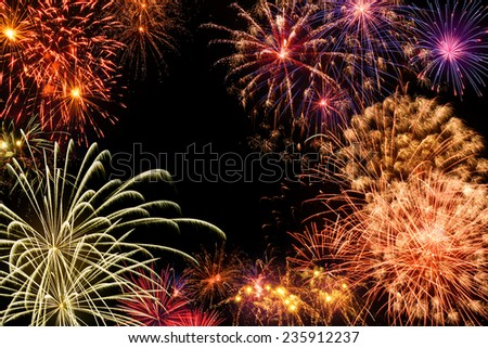 Fantastic multi-colored fireworks display on black night sky - stock photo