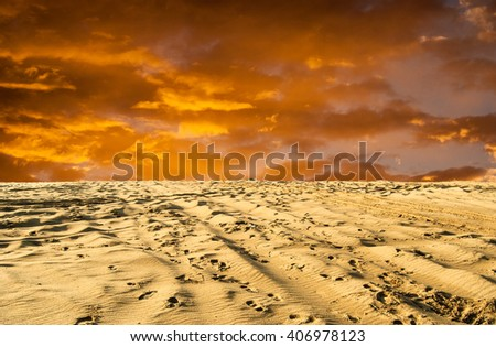 Fantastic orange and yellow view of desert at sunset - stock photo