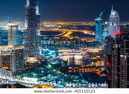 Fantastic rooftop view of a big modern city by night. Business bay, Dubai, United Arab Emirates. Travel background.  - stock photo