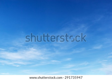 Fantastic soft white clouds against blue sky. - stock photo