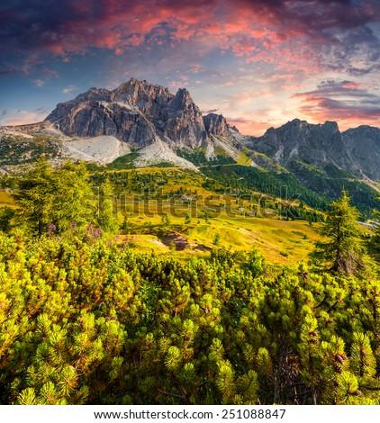 Fantastic summer sunrise on the Tofane mountain range. View from Falzarego pass. Dolomites mountains, Alps, Italy, Europe. - stock photo