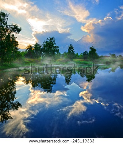 Fantastic sunset on a rural lake - stock photo