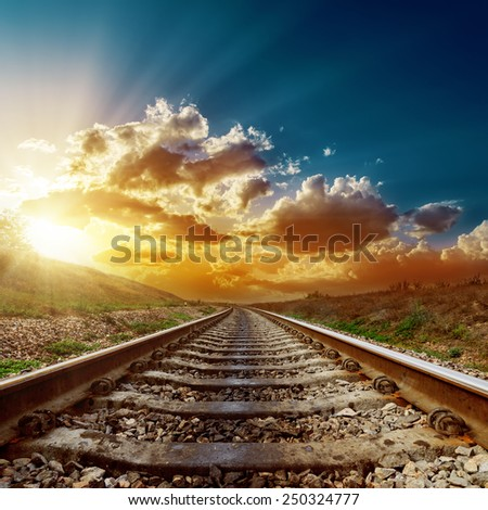fantastic sunset over railroad to horizon - stock photo