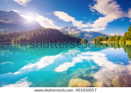 Fantastic view of the azure pond Champfer. Picturesque scene. Location: resort Silvaplana village, district of Maloja in the Swiss canton of Graubunden, Alps. Europe. Artistic picture. Beauty world. - stock photo