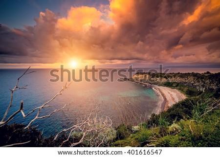 Fantastic view of the overcast sky. Dramatic morning scene. Location: cape Milazzo, nature reserve Piscina di Venere. Island Sicilia, Italy, Europe. Mediterranean and Tyrrhenian sea. Beauty world. - stock photo