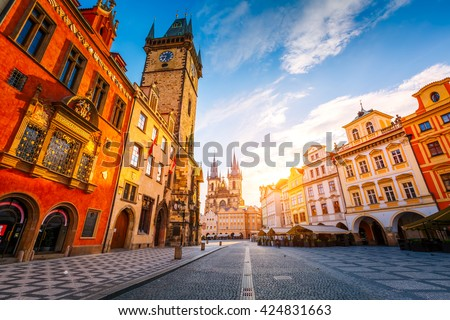 Fantastic view of the town Hall and Temple of Our Lady before Tyn in sunlight at dawn. Dramatic scene. Location famous place (unesco heritage) square on Prague, Czech Republic, Europe. Beauty world. - stock photo