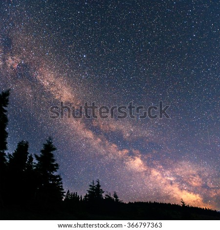 fantastic winter meteor shower and the snow-capped mountains - stock photo