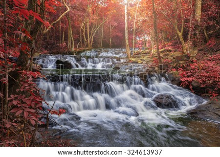 fantasy autumn beautiful water fall  - stock photo