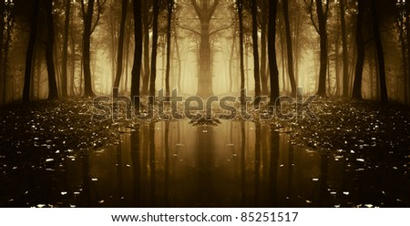 fantasy autumn forest with trees reflecting in water - stock photo